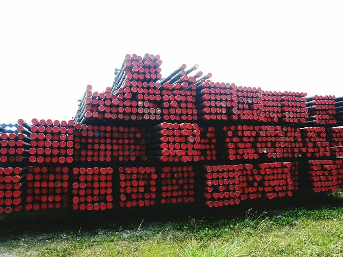 Oil and gas pipe casing on the open yard storage Stack Large Group Of Objects Grass Day Abundance Outdoors No People Sky Pipeline Pipe - Tube Pipes Casing Drilling Tube Tubing Drilling Drilling Pipe Oil And Gas Oil And Gas Industry