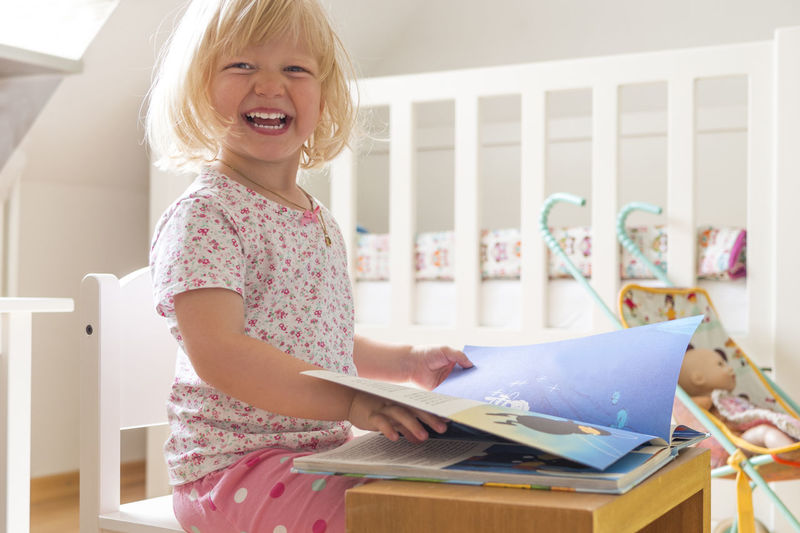 Adorable Appartment At Home Bed Book Child Cute Pets Education Female Fun Having Fun Laughing Nursery Playing Portrait Reading Smiling Teeth Toddler  Toothy Smile