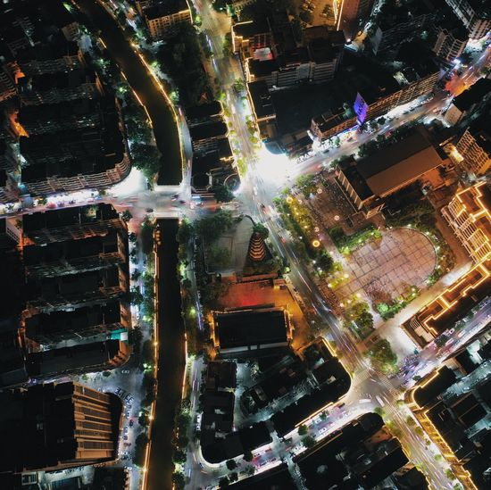 High angle view of buildings in city at night