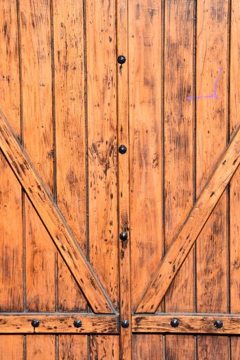 Backgrounds Brown Closed Door Entrance Metal No People Old Outdoors Pattern Protection Safety Security Textured  Wood Wood - Material Wood Grain
