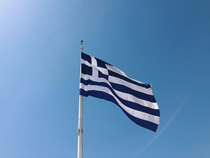 Greek flag against clear sky