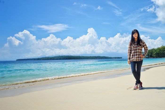 pasir putih beach Only Women Full Length Beach Young Adult One Woman Only Adults Only Sea One Person Sky People Smiling Vacations Cloud - Sky