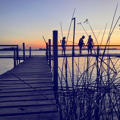Enjoying the sunset with friends Sunset Water Silhouette Real People Outdoors Lifestyles Tranquil Scene Clear Sky Nature Sky Beauty In Nature Fishing Pole Scenics Bluehour Day Argentina Golden Hour Entre Rios Blue Hour