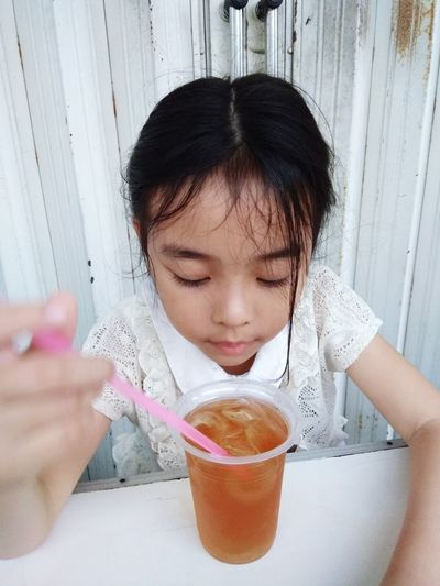 High angle view of girl having cold drink in restaurant