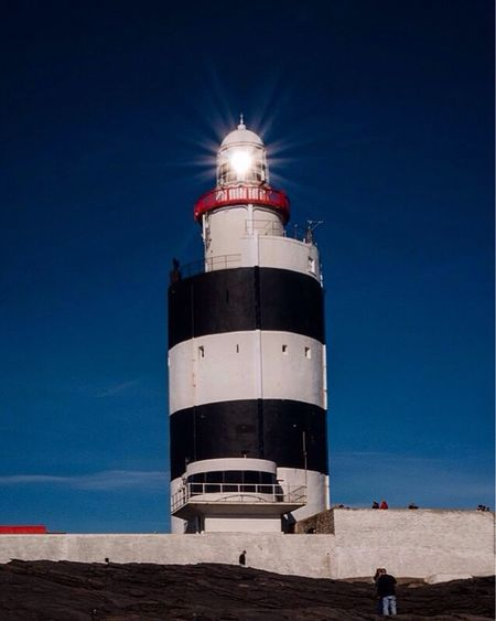 Shining Bright, Hook Lighthouse Co Wexford, Ireland Blue Lighthouse Sea Direction Built Structure Clear Sky Sky Architecture Beach Outdoors Day No People Ireland EyeEm Best Shots Nikon Photooftheday Popular Photos Composition Eye4photography  EyeEm EyeEm Gallery CreativePhotographer Architecture Picoftheday Light And Shadow