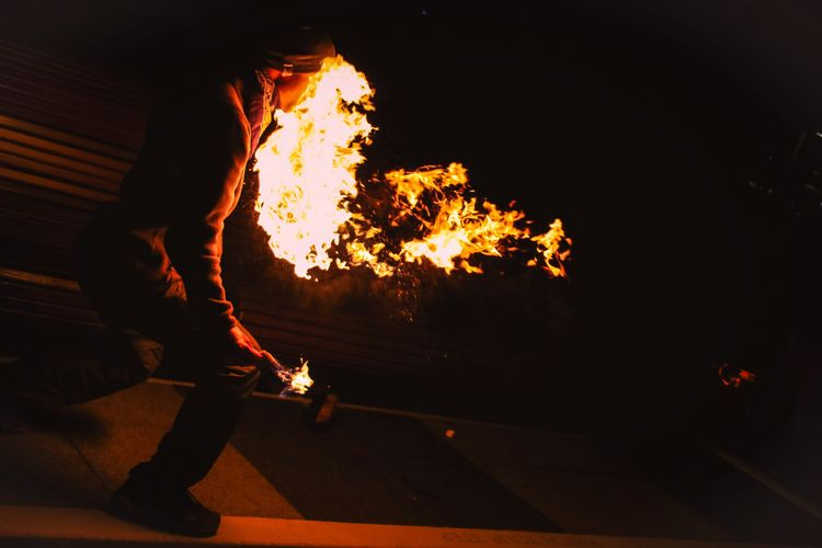 The fastest way to get rid of your eyebrows😂 Heat - Temperature One Person Flame One Man Only Burning Danger Speed People Skill  Urgency Real People Adult Outdoors Flame Burning Burningman Night Nightphotography Fire Dangerous Danger Zone Performer  Performance Show Flames Temperature