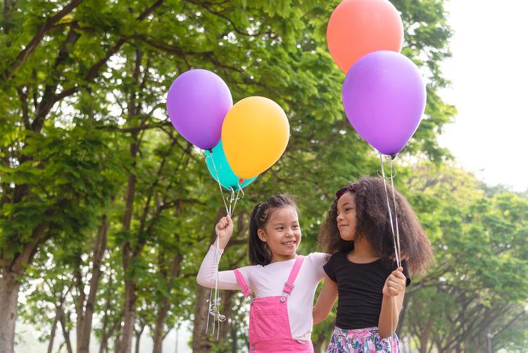 Happy girl holding balloons