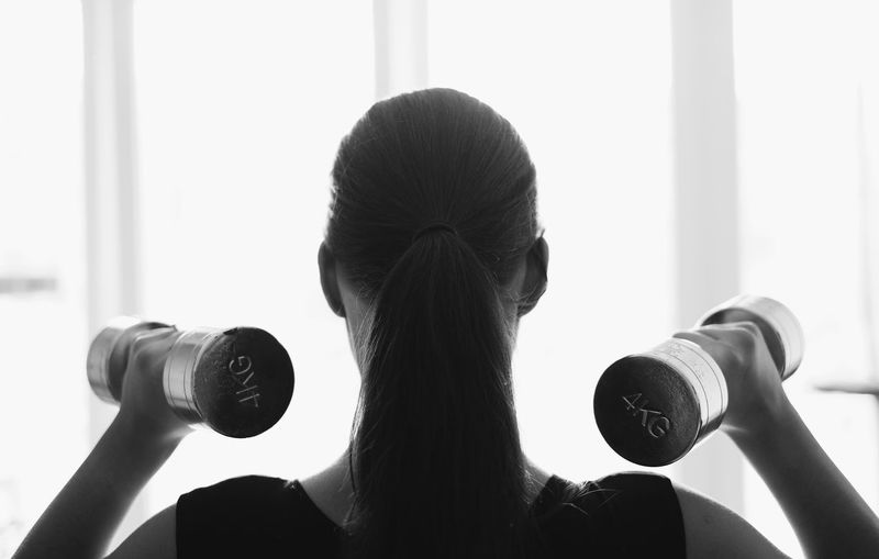 Close-up Exercise Equipment Exercising Gym Headshot Health Club Holding Lifestyles One Person Real People Rear View Women