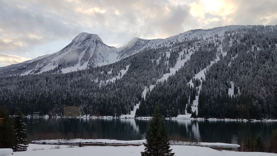 EyeEm Selects Water Mountain Snow Cold Temperature Winter Lake Frozen Water Snowcapped Mountain Reflection Sky Dramatic Landscape First Eyeem Photo
