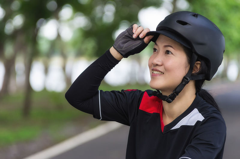 Bike Helmet - Asian women wearing helmets prepared cyclists. Helmet Bicycle Woman Bike Female Cyclist Wearing Happy Adult Smile Protection Girl person People Portrait Lifestyle Recreation  Beautiful Biker Safety Protective Sport Caucasian Young Outdoor White One Healthy Activity Leisure Cycle Fit