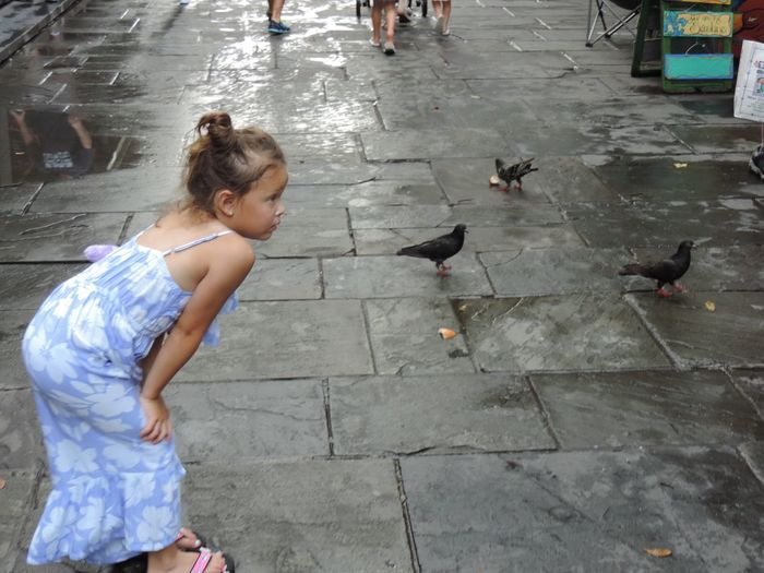 Girl Bending While Standing On Street