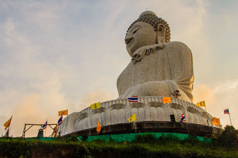 Amazing Massive white marble Buddha statue, the famous tourist attraction on top of hill in Phuket, Thailand. Big Buddha Marble Statue Massive Stone Buddha Architecture Big Buddha Temple Big Buddha Statue Big Buddha, Thailand Building Exterior Built Structure Day Flag Giant Buddha Low Angle View Marble Buddha Marble Stone Nature No People Outdoors Patriotism Sculpture Sky Statue Worship Places