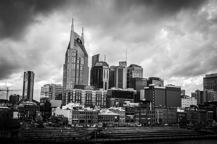 Downtown Nashville, Tennessee with some low clouds making for a dramatic look. Cityscape Dramatic Sky Skyscrapers Architecture Blackandwhite Building Exterior Built Structure City Cityscape Cloud - Sky Day Modern No People Outdoors Sky Skyscraper Tower Travel Destinations Urban Skyline