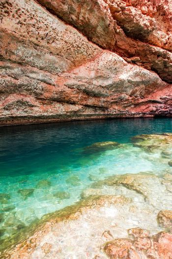 Oman Chapters Rock Solid Water Rock - Object Beauty In Nature Scenics - Nature Sea No People Nature Tranquil Scene Rock Formation Tranquility Land Idyllic Mountain Travel Destinations Day Beach Outdoors Turquoise Colored Bay Eroded