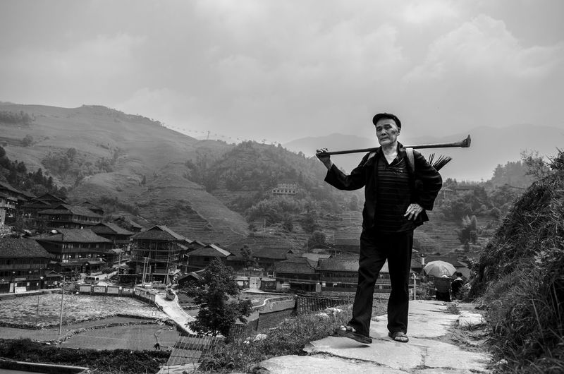 Full length of man playing on mountain against sky