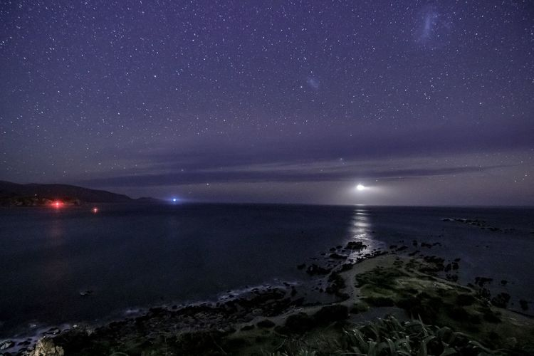 Astronomy Beach Beauty In Nature Horizon Horizon Over Water Idyllic Illuminated Land Nature Night No People Outdoors Scenics - Nature Sea Sky Space Star - Space Tranquil Scene Tranquility Water