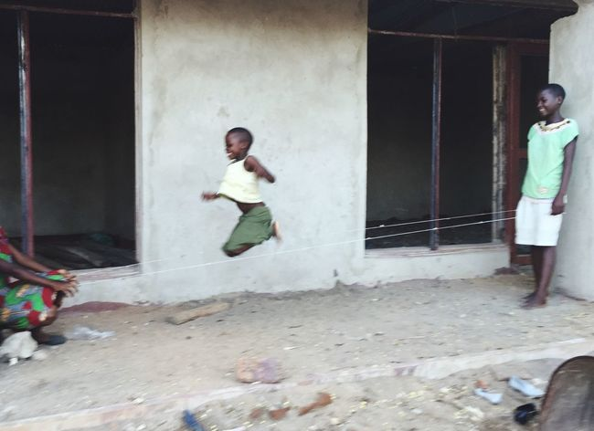 EyeEmNewHere Little Girl Child Jumping Skipping Rope Africa Malawi Motion Blur Motion Fun Girl Play Mid-air Happy Innocence Local Life Real People Travel Africa Day To Day African Girl  Africa Games AFRICAN CULTURE Childhood
