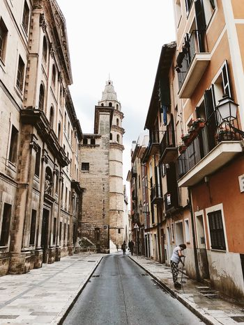 Palma de Mallorca, Spain Church Tower Cleaning Mediterranean  Palma De Mallorca SPAIN Woman Alley Architecture Broom Building Building Exterior Built Structure Day One Person Outdoors Real People Residential District Street White Sky