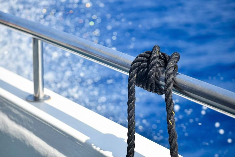 Rope Day Focus On Foreground Nature Water No People Close-up Tied Up Outdoors Metal Railing Security Strength Transportation Blue Connection Safety Wood - Material Sky Ocean Spray Copy Space