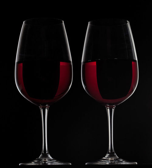 Two red wine glasses with wine on black background Black Background Celebration Copy Space Isolated Red Wine Alcohol Backgrounds Black Black Background Close-up Drink Drinking Glass Food And Drink No People Red Red Wine Studio Shot Wine Wine Cask Wineglass Winetasting