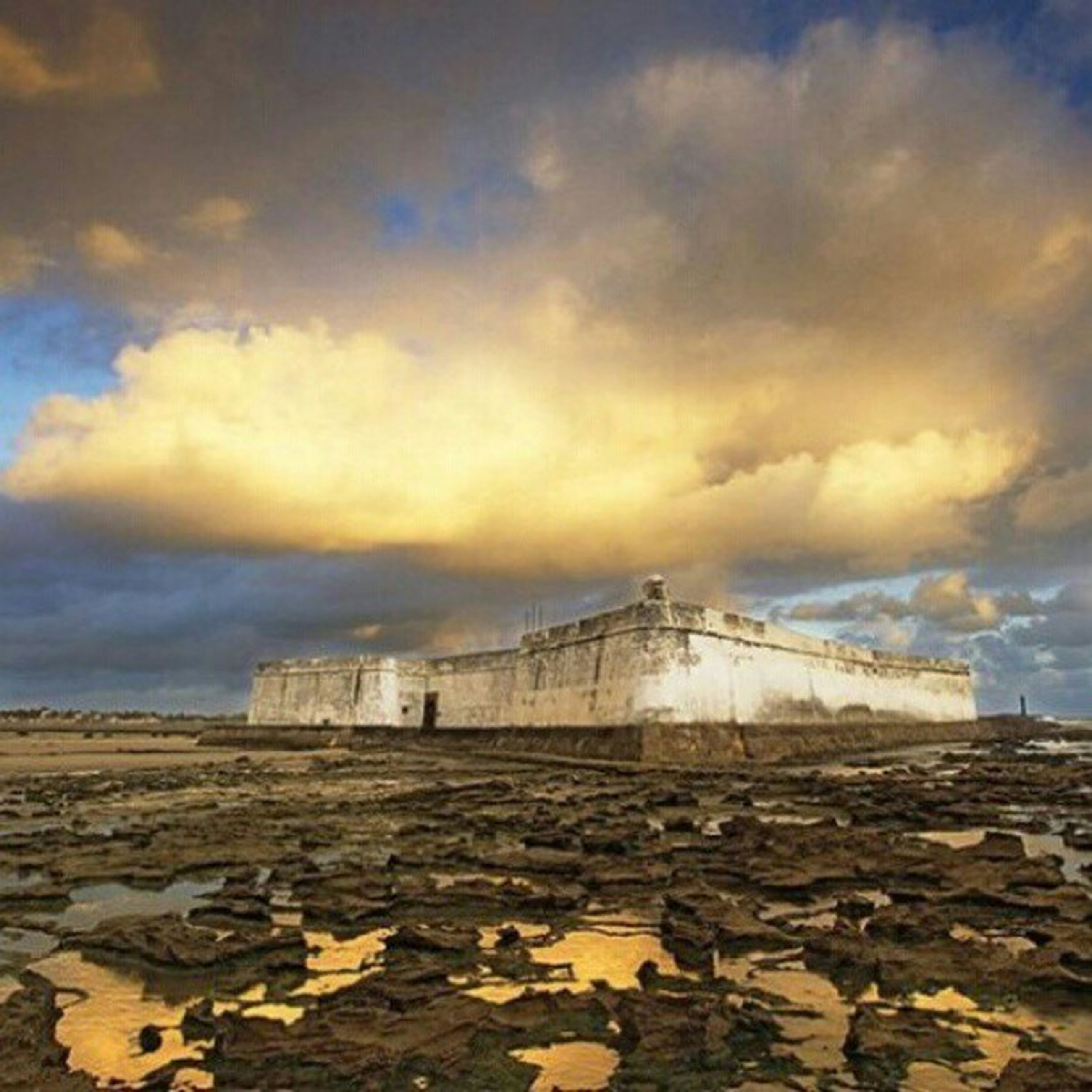 sea, water, sky, horizon over water, sunset, cloud - sky, beach, built structure, shore, scenics, architecture, beauty in nature, nature, tranquility, pier, tranquil scene, cloudy, cloud, idyllic, rock - object