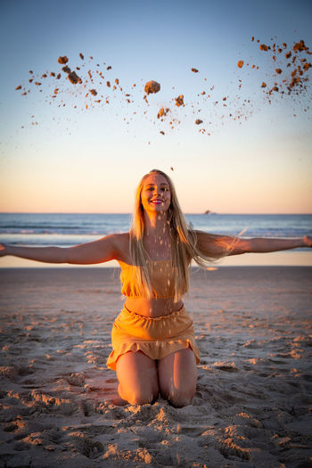 Kirrilee :) 1970s Beach Beautiful Woman Front View Hair Hairstyle Horizon Over Water Land Leisure Activity Long Hair Looking At Camera One Person Outdoors Portrait Sand Sea Sky Sunset Water Women Young Adult Young Women The Fashion Photographer - 2018 EyeEm Awards
