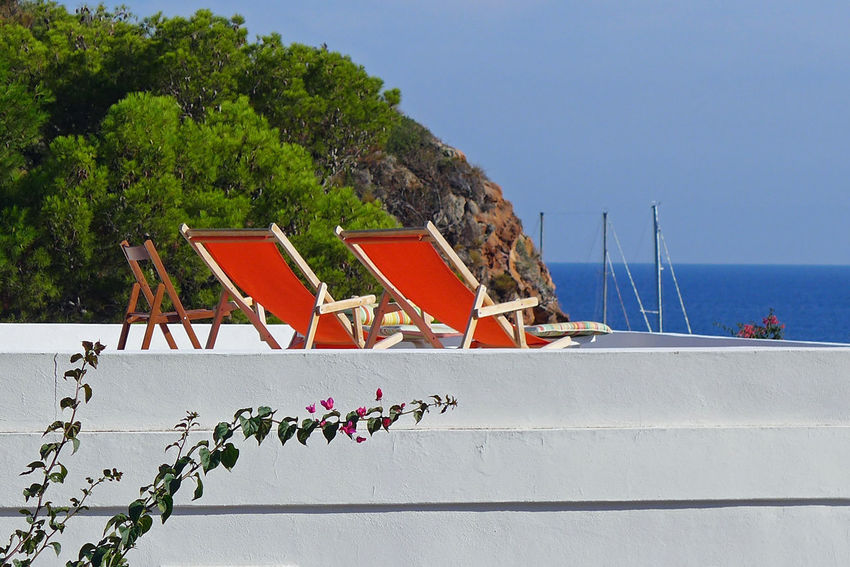 Eolian Islands Sicily Blue Sky Panarea  Red Deck Chairs White Foreground