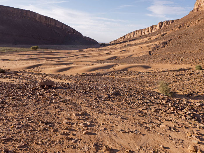 Trekking adventure in the desert Sahara in Morocco Tafraout Morocco Adventure Mountain Table Mountain Outdoors Formation Rock Formation Rock Sunlight Arid Climate Climate Desert Landscape Gravel Scree Valley Sahara Sand Wilderness Canyon Africa Eroded Tranquility Environment