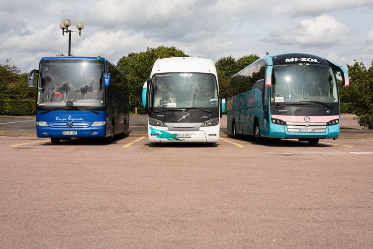 Three luxury left hand drive European coaches parked at Stratford upon Avon coach park. Coach Drop Off Head On Luxury Travel Parking Bay Transportation Bus Bus Stop Coach Park Day Luxury Coaches No People Outdoors Parking Parking Bay Pick Up Transportation