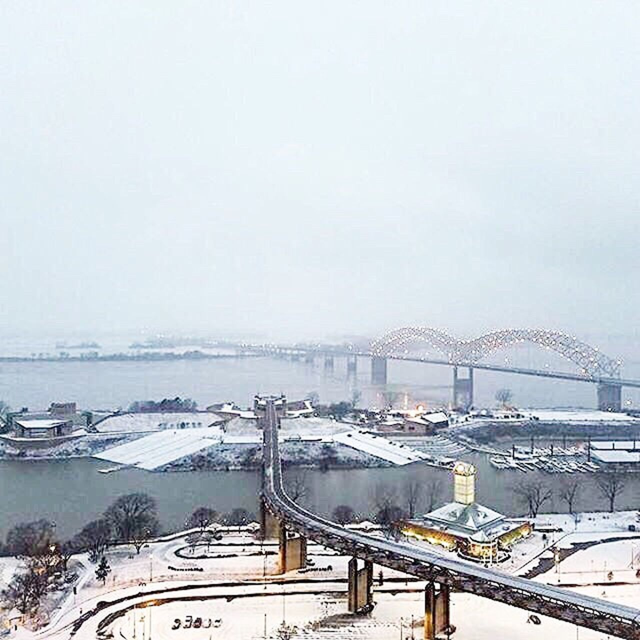 winter, cold temperature, snow, sea, bridge - man made structure, fog, outdoors, water, no people, day, built structure, nature, city, architecture, harbor, ferris wheel, building exterior, sky, cityscape, beauty in nature