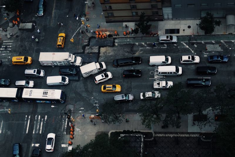 Yellow cabs in a grey city 🚕 Transportation Land Vehicle New York New York City Manhattan High Angle View City Road Building Exterior Street Architecture Built Structure Traffic City Life On The Move City Street Outdoors Day Aerial View No People Vehicle Battle Of The Cities Stories From The City