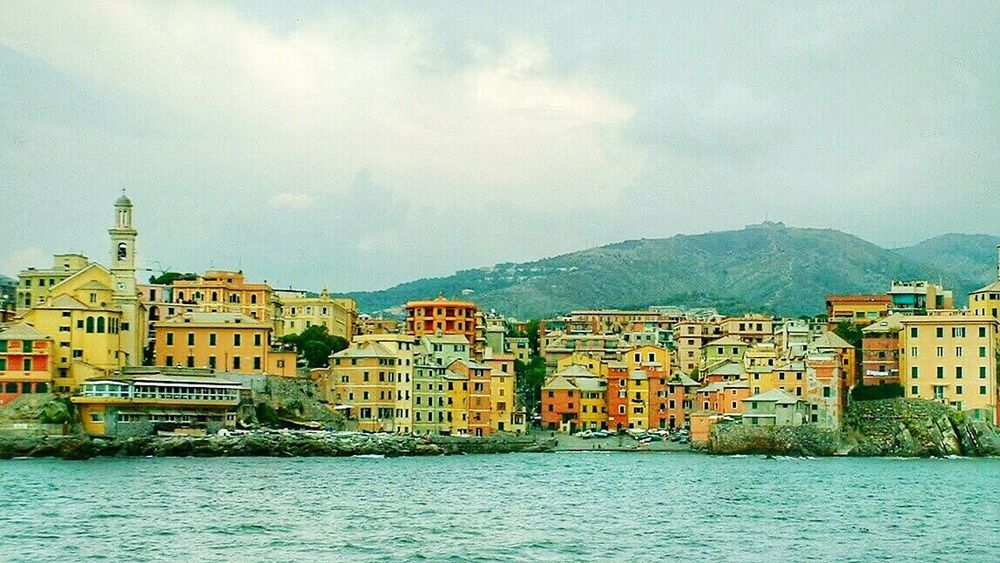 """""""Boccadasse in Genova"""" a beatiful spot out of time, inside the city! Fishermen Village (borgo) formerly out of the walls and then fully part of the city. Colorful Houses Seaside Genoa Genova Italy In A Sea Town Sea And City Seashore"""