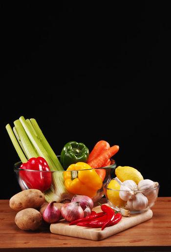 Fruits and vegetables on black background