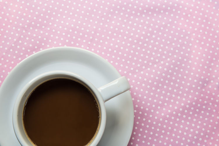 Close-up Coffee Coffee - Drink Coffee Cup Crockery Cup Directly Above Drink Food And Drink Freshness Hot Drink Indoors  Mug No People Non-alcoholic Beverage Pattern Refreshment Saucer Studio Shot Table Tablecloth Tea Cup