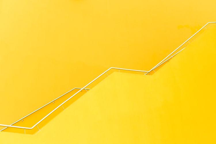 High angle view of cross on yellow wall