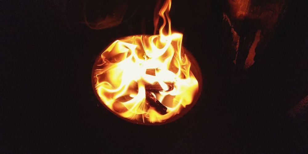 Close-up of fire burning at night