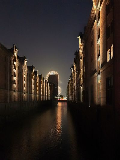 View of buildings lit up at night