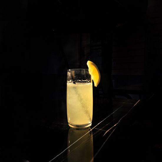 Close-up of drink on table against black background