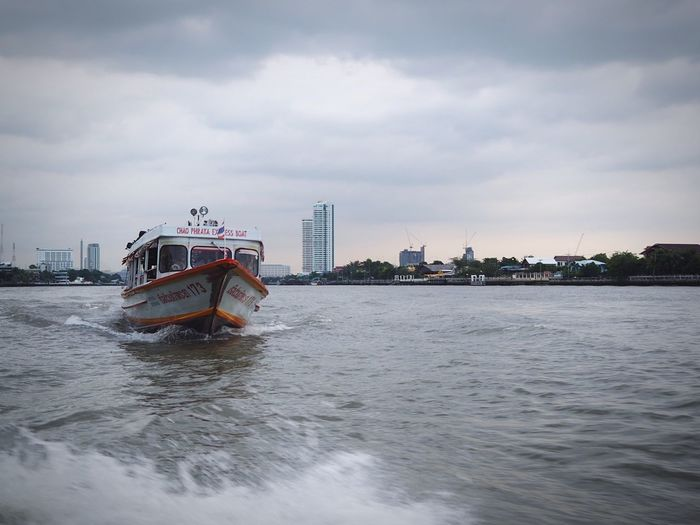 Speed boat. HelloEyeEm Thailand Banngkok City Chao Phaya River Outside Speedboat River View City Life Water Cloud - Sky Sky Architecture Safety Transportation Nature Built Structure Travel Destinations City Outdoors Protection Mode Of Transportation Nautical Vessel Day