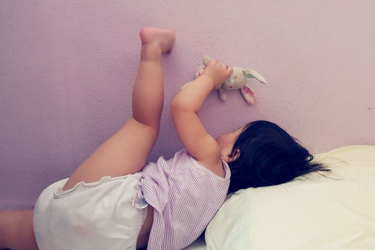 Having a secret conversation with her bunny 😁😁 Girl Niece  Baby Girl Pink Wall Hello World Personal Perspective My Point Of View Showcase July Mobilephotography Human Hand Bedroom Relaxation Lying Down Back Low Section Human Leg Human Feet The Portraitist - 2019 EyeEm Awards The Mobile Photographer - 2019 EyeEm Awards
