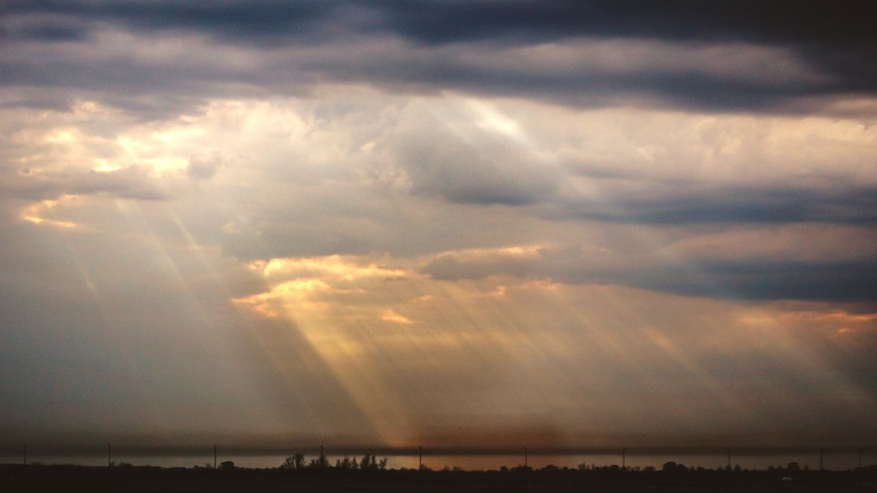 cloud - sky, beauty in nature, scenics, sky, tranquility, sunset, atmospheric mood, nature, sunbeam, sun, tranquil scene, no people, sunlight, outdoors, backgrounds, day