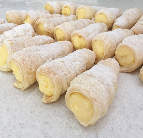 Traditonal Austrian dessert with puff pastry and filled with cream Austrian Bakery Close-up Cream Creamy Delicious Dessert Dough Filled Food Food And Drink Food And Drink Freshness German Gourmet Indoors  Kremrole Pastry Puff Schaumrolle Sugar Sweet Tasty Whipped