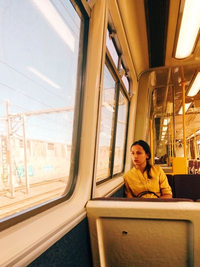 Yellow Summer The Portraitist - 2018 EyeEm Awards Commute Vehicle Interior Window One Person Mode Of Transportation Sitting Transportation Travel Looking Train - Vehicle Journey Glass - Material Public Transportation Rail Transportation Portrait Leisure Activity Young Adult Outdoors Train Adult Architecture