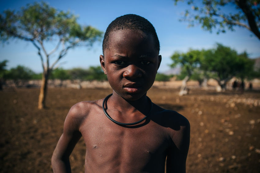 Himba Tribe, Damaraland, Northern Namibia Africa African African Beauty Fine Art Photography Blue Sky Boy Boys Dirt Ethnic Headshot Himba Hut Indigenous  Mid Adult Mid Adult Men Namibia Ochre Portrait Remote Rural Short Tribal Tribe Village Young Men Resist EyeEm Diversity
