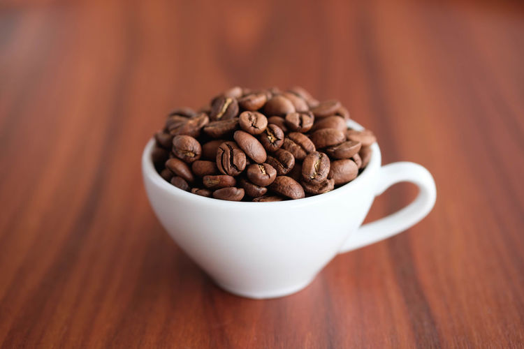 Food And Drink Coffee - Drink Coffee Food Roasted Coffee Bean Table Brown Freshness Close-up Indoors  Drink Cup Still Life Wood - Material Mug Refreshment Coffee Cup No People Large Group Of Objects Focus On Foreground Caffeine Latte Crockery Snack
