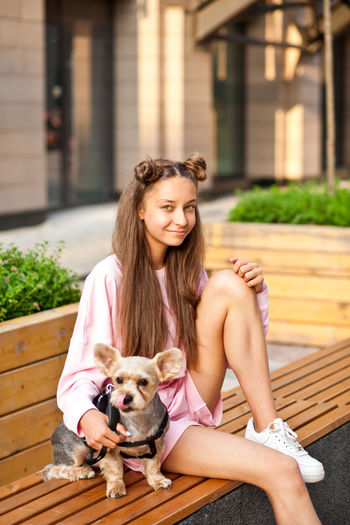 Portrait of young woman with dog
