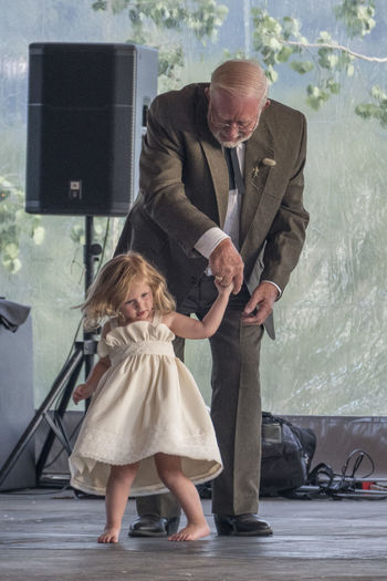 Grandfather dancing with granddaughter