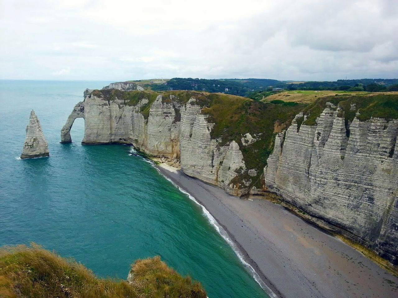 Cliff by sea at etretat