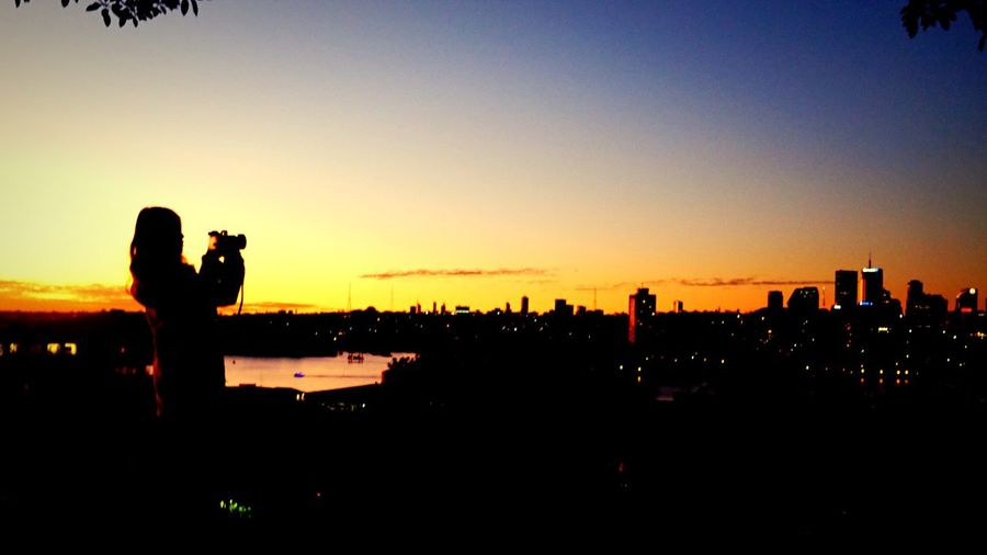 Silhouette of cityscape at sunset
