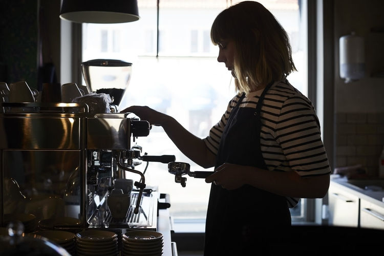 Side view of a woman with coffee